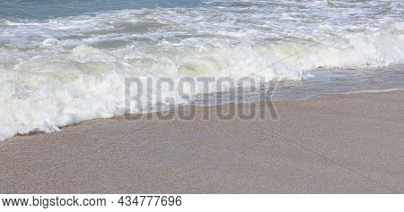 Beautiful Seascape With Beautiful Sea Waves And Sea Foam On Shore With Sea Water On Beach By Sea