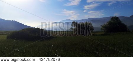 View Of The Mountains With Fog, In The Morning