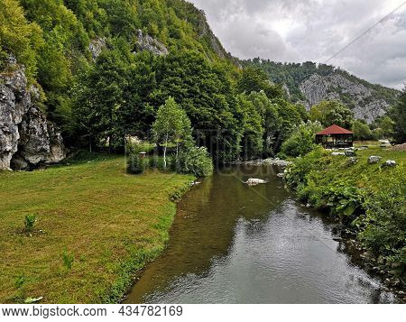 Summer Landscape In The Mountains With River