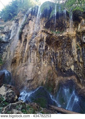The Pisoaia Waterfall  Is 18 M Hight With A Spread Of The Watercourse Of 25m On The Rocky Steep Slop