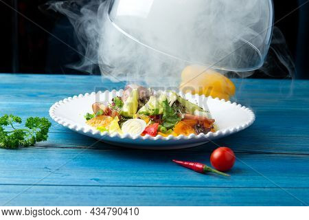 Fried Perch With Vegetables In A Plate. On A Blue, Wooden Background. Selective Focus