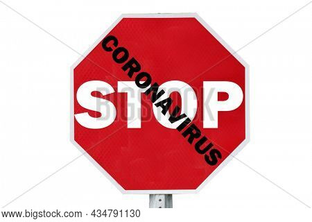 Stop Sign. Red Stop Sign. Stop sign reads STOP CORONAVIRUS isolated on white with Coronavirus logo in background. Covid-19 is around the world and dangerous. Stay Safe. Coronavirus Christmas.