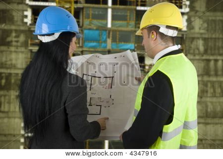 Engineer And Buyer With Project On Site