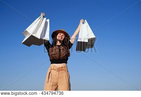 Retail, Consumerism Or Sale Concept - Happy Woman With Shopping Bags. Attractive Shopaholic Brunette