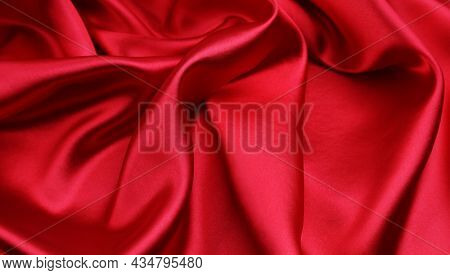 Closeup of rippled red silk fabric