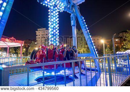 Maltepe, Istanbul, Turkey - 07.22.2021: Turkish Children Having Fun In Amusement Park Ride At Night