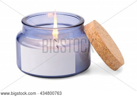 A Lit Scented New Candle In Glass On A White Insulated Background.