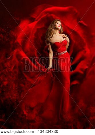 Sexy Model In Red Dress Dancing Over Fantasy Rose Background. Beauty Woman Art Portrait. Luxury Fash