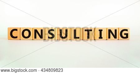 Consulting Symbol. The Word Consulting On Wooden Cubes. Beautiful White Table, White Background. Bus