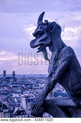 Gargoyle (chimera) Of Notre Dame De Paris Cathedral, France. It Is Landmark Of Paris City. Vertical