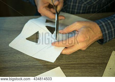 Making Jack O'lantern At Home. Jack O'lantern Thread Template Creation Process. The Man Prepares The