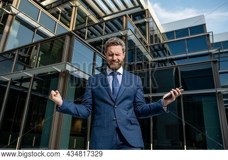 Crying Bearded Businessman In Formal Suit With Smartphone, Bankruptcy