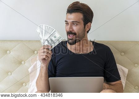 Financial, Banking, Currency Technology, Successful Concept. Happy Handsome Man With Laptop Looking