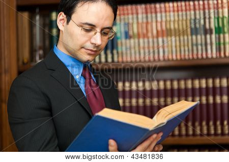 Young lawyer reading a book