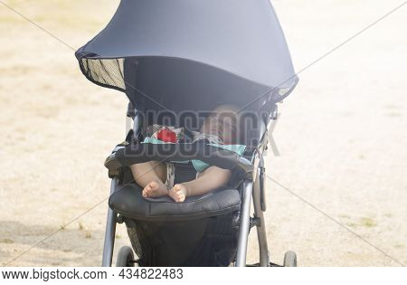 Sweet Little Baby Sleeping In Stroller In Summer Or Autumn Outdoors And Copy Space.