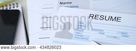 Ballpoint Pen Lying On Blank Job Resume Form Closeup