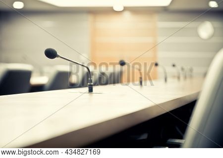 Microphone And Boardroom. Close Up The Conference Microphones On The Meeting Table Or Board Room For