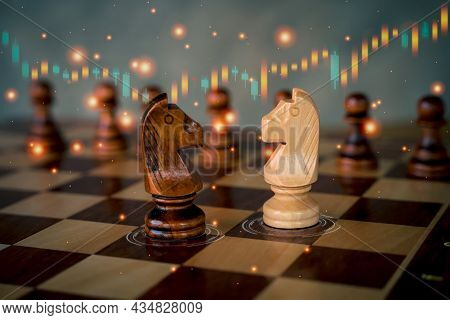Chess Horse With Up And Down Of Stock Market In Background. Business Development To Success With New
