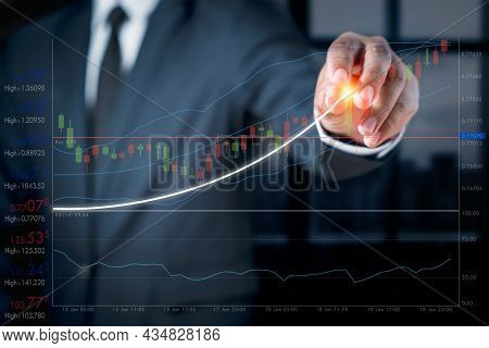 Businessman With A Graph Showing The Ups And Downs Of Stock. Concept Of Doing An Online Business Cal