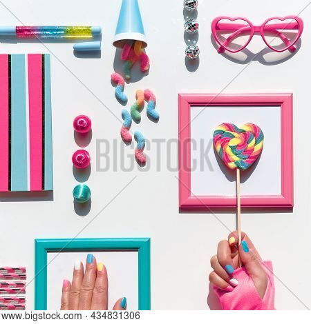 Collection Of Party Objects And Sweets, Top View, Flat Lay. Chocolate, Candy. Notebook And Rainbow L
