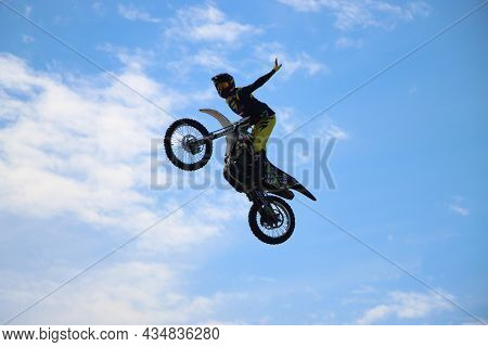 Sochi, Russia - 24.09.2021: Professional Freestyle Motocross Rider Fmx Giving Acrobatic Demonstratio