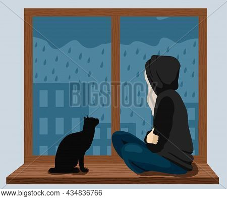 A Girl With A Cat Sits On The Windowsill And Looks At The Rain Outside The Window. The Girl Is Sad.