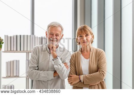 Portrait Of Happy Seniors Couple Standing And Looking At The Camera, Joyful Nice Elderly Couple Smil