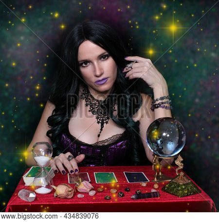 Psychic With Crystal Ball. And Tarot Cards On Galaxy Background