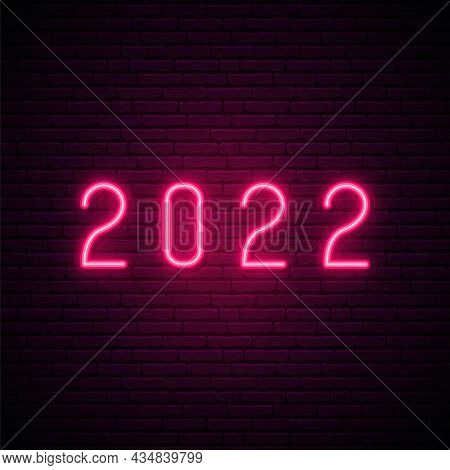 2022 Neon Signboard. Happy New Year. Realistic Pink Neon Numbers On Dark Brick Wall. Vector 2022 In