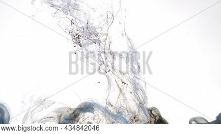 Colored Cloud Of Ink On A White Background. Blue, White And Black Watercolor Ink In Water On A White
