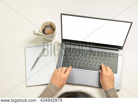 Laptop With Blank Screen, Hands And Accessories On White. Business Woman Hands Using Mockup Laptop W