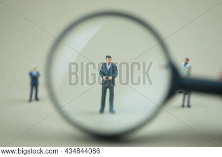 Miniature People: Magnifying Glass Focusing On The Selection Of Executive Businessman, Recruitment P