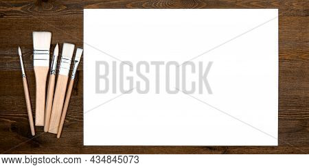 A Clean White Sheet And Brushes On A Wood Textured Background With Space To Copy. Layout, Mockup Spa