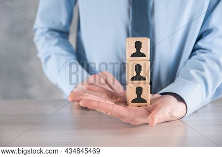 Businessman Hold And Put Wooden Cube Block Shape With User Icon On Grey Table. Space For Text. Inter