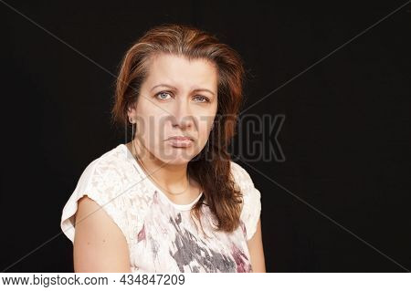 Portrait Of Tired Sad Woman On Black Background. She Is Tired Of The Rich Rhythm Of Life. A Woman Th