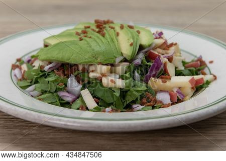 Spinach Salad Topped With Avocado Over Chopped Vegetables For A Healthy Portion To Your Meal Plan.