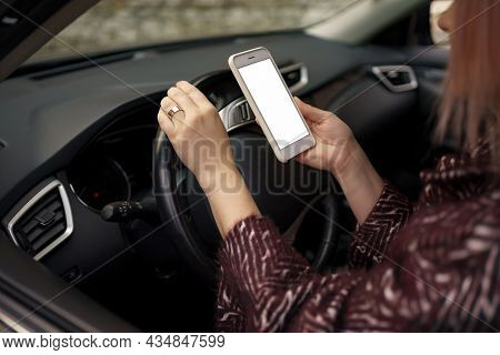 Mockup Image Of A Woman Holding, Using Mobile Phone With Blank Screen While Driver A Car.