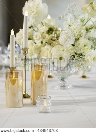 Table Served For Banquet. Electric And Real Candles In Shiny Candle Holders As Decoration. Table Wit