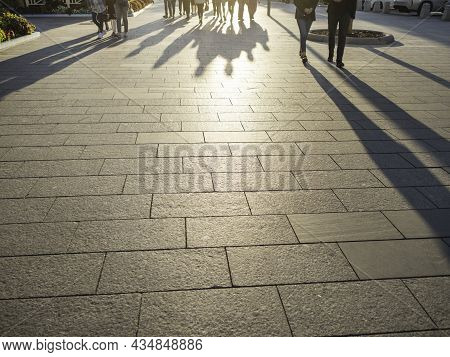 Moscow, Russia - August 22, 2021. Shadows Of Walking People On Famous Novy Arbat Street. Warm Summer