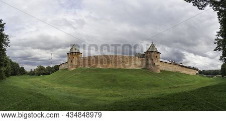 Panorama View Of Walls And Fyodorovskaya And Mitropolichya Towers Of Novgorod Kremlin. Summer Cloudy