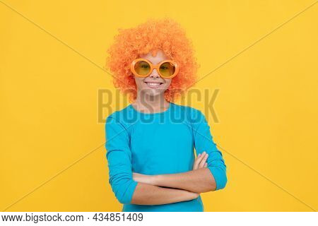 Pleasant Smile. Happy Childhood. Girls Birthday Party. Happy Funny Kid In Curly Wig. Time For Fun.