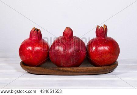 Wooden Plate With Ripe Pomegranates On White Background, Red Fresh Fruits, Raising Hemoglobin