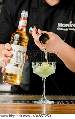 Ukraine, Kyiv - March 12, 2021: Selective Focus On Beautiful Crystal Glass In Which Bartender Pours