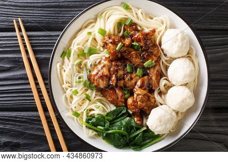 Indonesian Food Mie Ayam Egg Noodles With Fried Chicken Meat And Meatballs Close-up In A Bowl On The