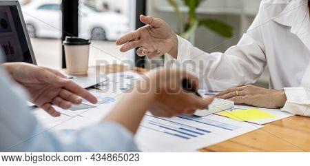 Atmosphere In The Meeting Room Of Startup Companies, Executives And Sales Departments Gather Togethe