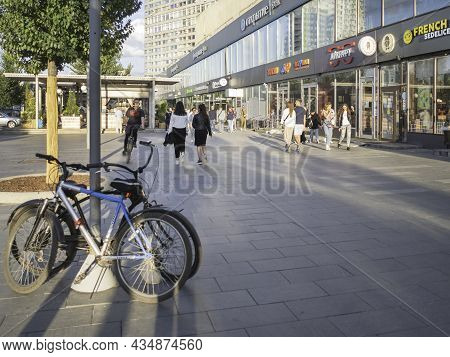 Moscow, Russia - August 22, 2021. Tourists And Local People Walk And Ride Bicycle On Famous Novy Arb