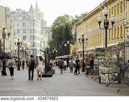 Moscow, Russia - August 08, 2021. Local People And Tourists Walk Down Famous Arbat Street With Souve