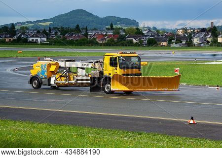 Salzburg, Austria - May 20, 2013: Airport Runway Cleaning. Airfield Concrete And Asphalt Surface Cle