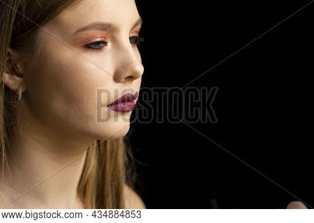 Makeup Artist Applies Red Lipstick On A Beautiful Woman Face. Hand Of Make-up Master, Painting Lips