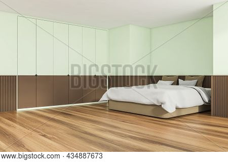 Interior Design Of Trendy Bedroom In Soft Shade Of Green. Wood Floor, Basement Ledge, Comfortable Be